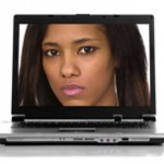 woman's face on laptop screen
