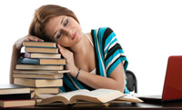 College woman resting her head on a pile of books