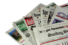 newsxapper sections in a pile