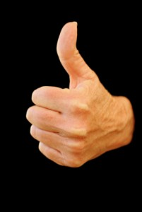 A hand with a thumb pointing upward