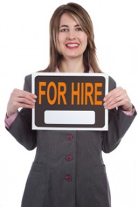 "publicist holding ""for hire"" sign"