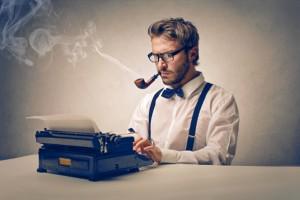 man typing a press release