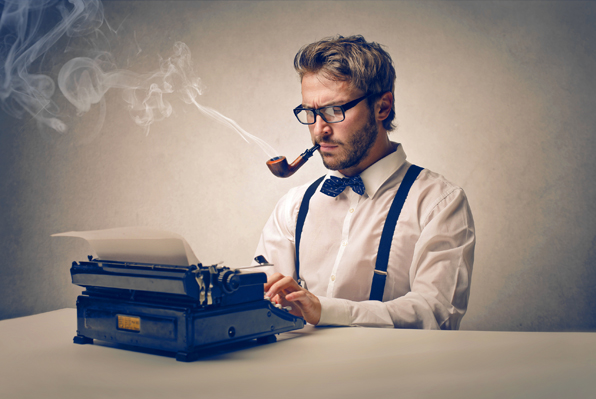 Man smpoking pipe and typing on manual typewriter