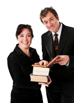 man and woman reviewing a book
