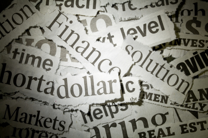 Headlines cut from a newspaper and piled atop one another