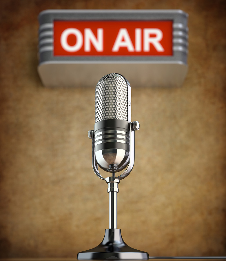on air light behind poddcasting microphone