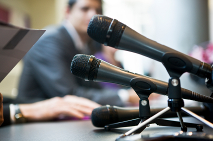 microphones on a press conference table