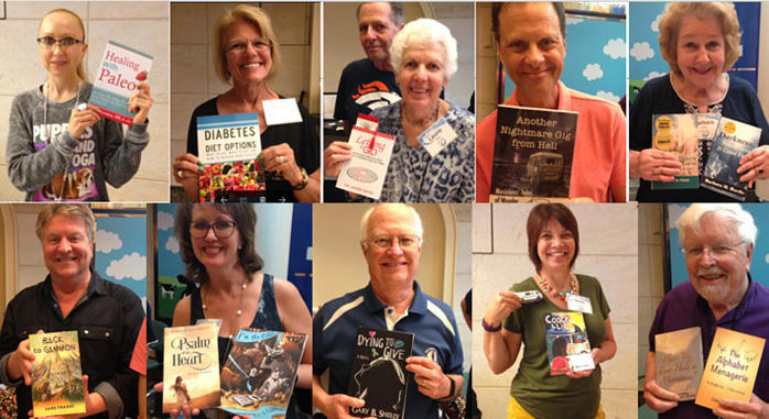 8 authors holding up books